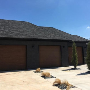 Huge arts and crafts attached four-car garage photo in Oklahoma City