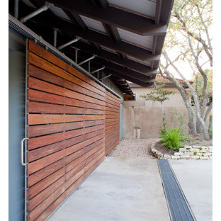 Design ideas for a mid-sized industrial attached two-car carport in Austin.