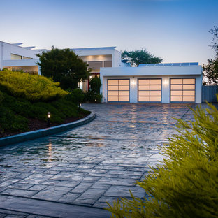 Inspiration for a contemporary garage in San Francisco with three or more cars.