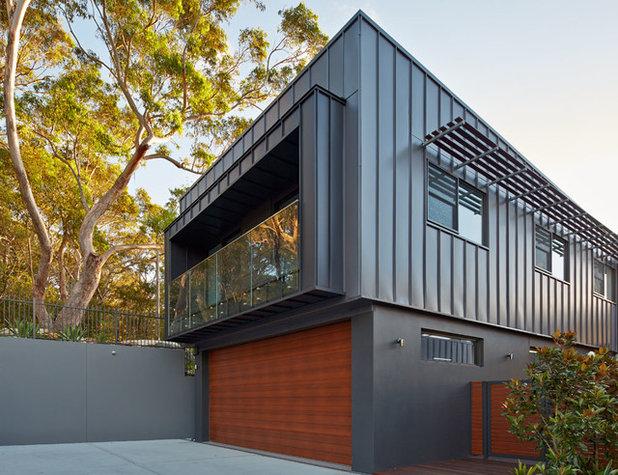 Contemporary Garage by Sanctum Design