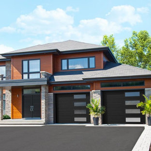 Réalisation d'un garage pour deux voitures attenant design de taille moyenne.