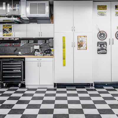 Inspiration for a large contemporary attached garage workshop remodel in New York