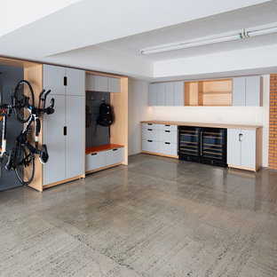 This is an example of a large modern attached double garage workshop in San Francisco.