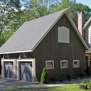 Example of a farmhouse attached two-car garage design in New York