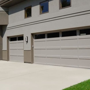 Large trendy attached three-car garage photo in Dallas