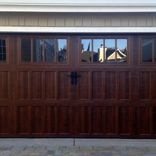 Mid-sized elegant attached two-car garage photo in Seattle