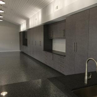 Huge minimalist attached garage workshop photo in Detroit