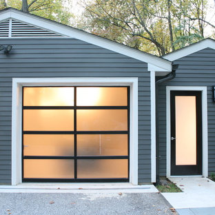 Example Of A Mid Sized Transitional Detached Two Car Garage Design In Baltimore