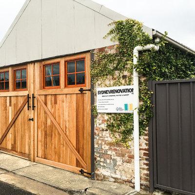 Inspiration for a large rustic detached three-car garage workshop remodel in Sydney