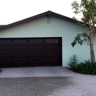 Mid-sized midcentury modern attached two-car carport photo in San Diego