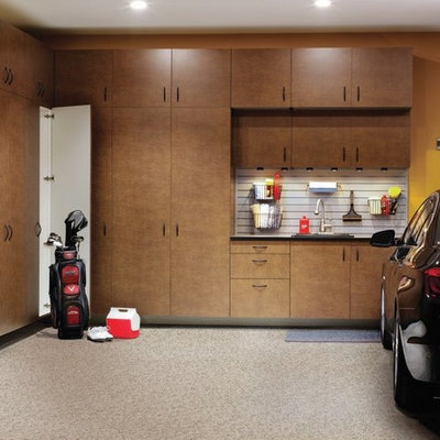 Example of a large transitional attached garage design in Other