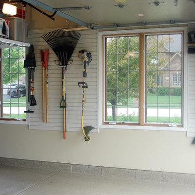 Garage workshop - mid-sized transitional attached garage workshop idea in Kansas City