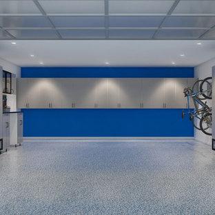 Idée de décoration pour un grand garage pour deux voitures design.