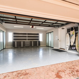 Example of a mid-sized transitional attached two-car garage design in Hawaii