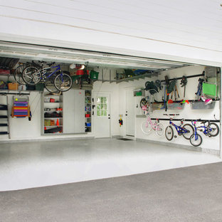 Garage - mid-sized contemporary attached two-car garage idea in New York