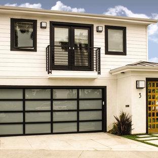 Inspiration för en funkis tillbyggd tvåbils garage och förråd