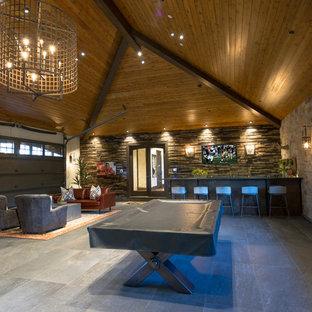 Example of a huge arts and crafts attached garage workshop design in Denver