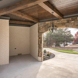 Inspiration pour un garage pour deux voitures attenant craftsman de taille moyenne avec une porte cochère.