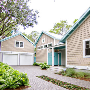 Inspiration for a large tropical detached two-car garage remodel in Jacksonville