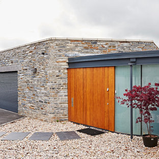 This is an example of a large contemporary attached single garage in Devon.