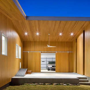 Inspiration for a mid-sized contemporary attached two-car garage remodel in Austin