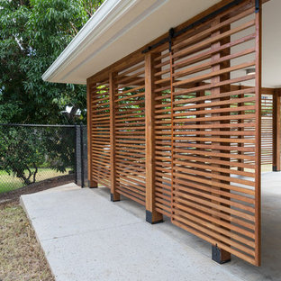 Inspiration for a large contemporary detached two-car carport remodel in Hawaii