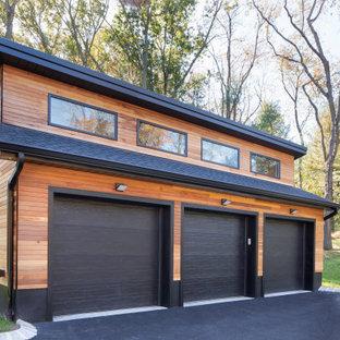 Trendy detached three-car garage photo in New York