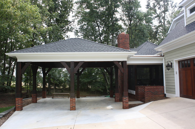 Traditional Garage And Shed by Artisan Custom Homes