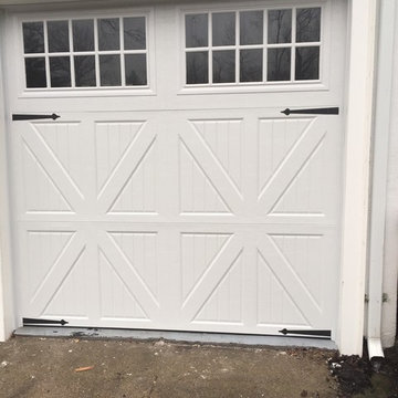 installation of 3 carriage style garage doors with 3 openers