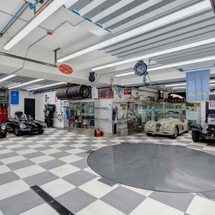 Example of a transitional four-car garage design in Other