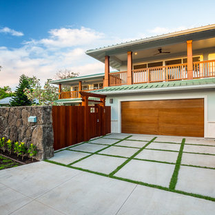 Design ideas for a large tropical attached two-car garage in Hawaii.