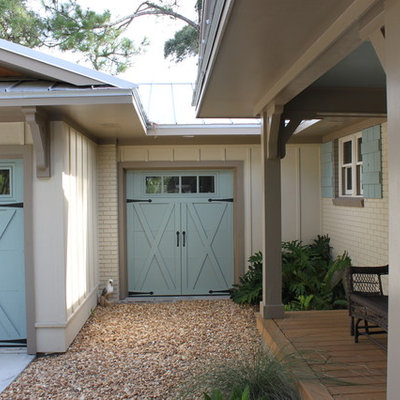 Garage - mid-sized tropical attached one-car garage idea in Jacksonville