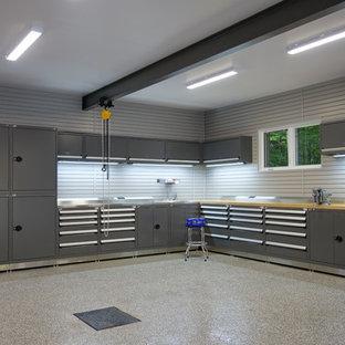 Garage - huge contemporary detached three-car garage idea in Montreal