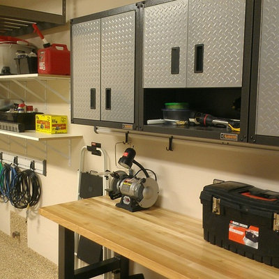 Inspiration for a mid-sized transitional attached two-car garage workshop remodel in Denver