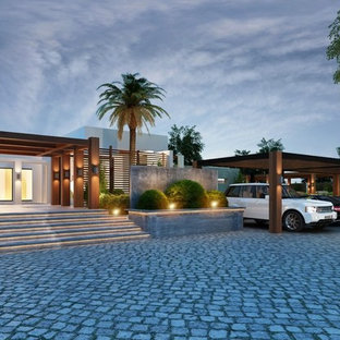 Example of a huge minimalist detached four-car carport design in Other