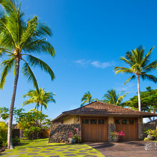 Example of a large island style detached two-car garage design in Hawaii