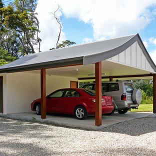 Exotisk inredning av en mellanstor fristående tvåbils carport