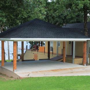 Carport - large beach style detached two-car carport idea in Dallas