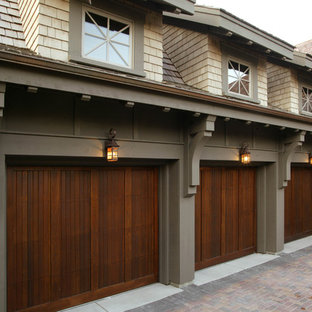 Example of a large classic attached three-car garage design in Minneapolis