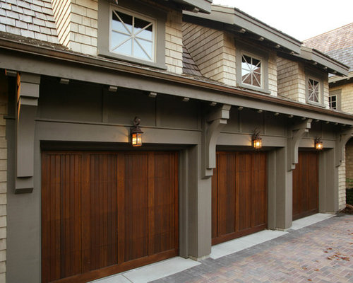 Example Of A Large Classic Attached Three Car Garage Design In Minneapolis
