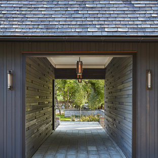 Example of a mountain style one-car carport design in Minneapolis
