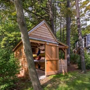 This is an example of a small beach style detached boathouse in Milwaukee.