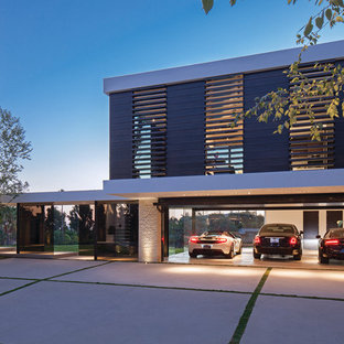 Garage - large contemporary attached three-car garage idea in Los Angeles