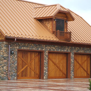 Example of a huge arts and crafts detached three-car garage design in Charlotte