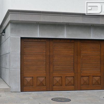 Garage - large transitional two-car garage idea in Orange County