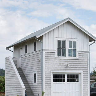 Garage - small beach style detached one-car garage idea in Seattle