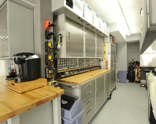 Foto e idee per garage e rimesse grandi garage e rimesse for Un garage per auto con appartamento
