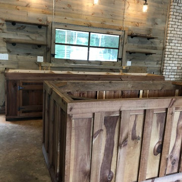 Man Cave Garage Remodel- weathered wood stain, open shelving, rustic cabinets