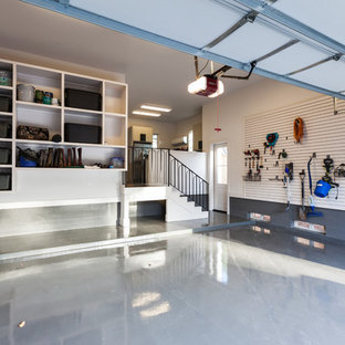 Example of a huge transitional attached two-car garage workshop design in Houston