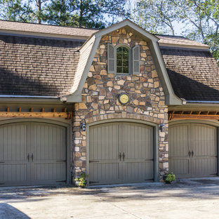 Example of a large classic detached three-car garage design in Atlanta